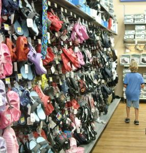 Middle Son checking out Wal-Mart's Wal-o-Shoes