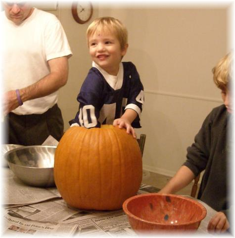 """Peezer"", up to his elbows in his future jack o'lantern"