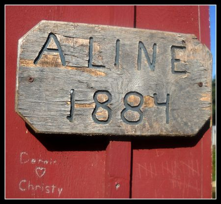 Aline covered bridge sign